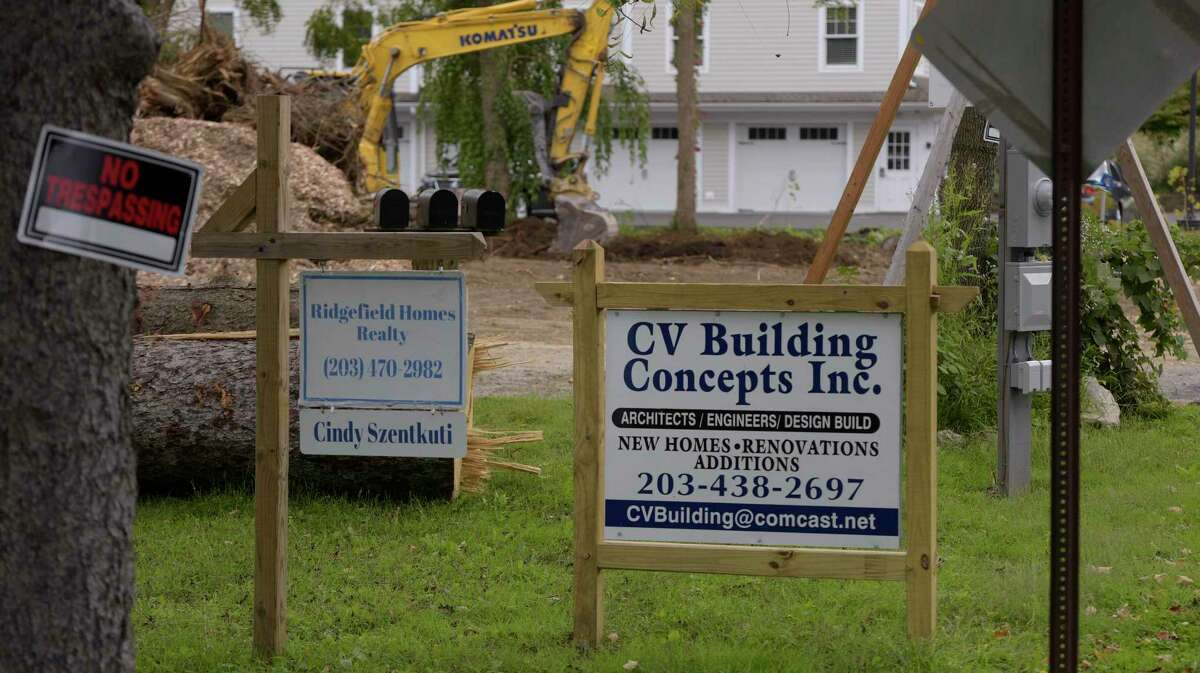 CV Building Concepts razed houses at 8 and 10 New Street. Thursday, Sept. 30, 2021, Ridgefield, Conn.