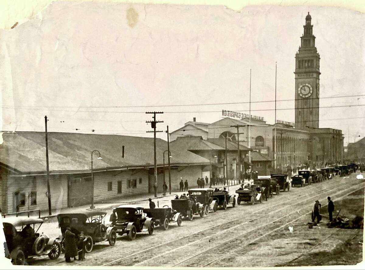 Automobiles line up at the Ferry Building in San Francisco in 1915, waiting for a ferry arrival from Sausalito.