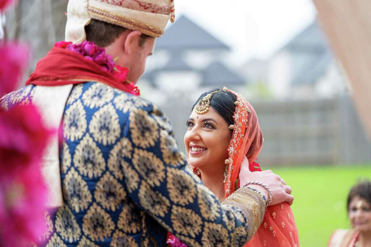 Megha Tejpal and Patrick McSwain tied the knot in spring 2021 with a backyard Hindu ceremony at the bride's parents' home in Sugar Land and a black-tie, white dress ceremony at Asia Society Texas Center in the Museum District.