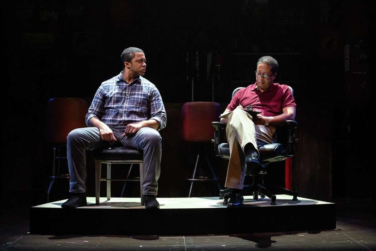 """Derrick J. Brent II as Chris and David Rainey as Evan perform in the Alley Theatre production of """"Sweat."""""""