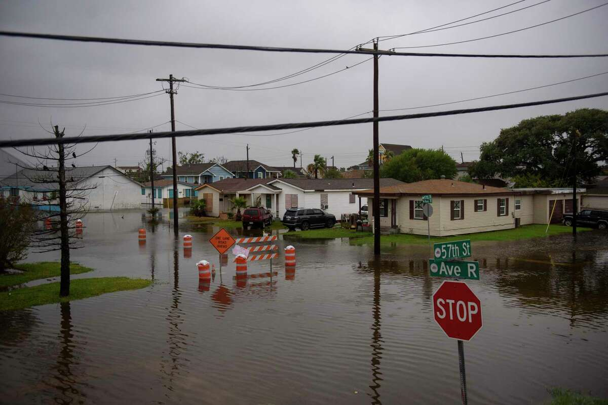 Nicholas produced powerful wind gusts and heavy rain in Galveston after making landfall Sept. 14 as a hurricane. A climate report shows the state is experiencing extreme rainfall - especially in eastern Texas - bigger storm surges as seas rise along the Gulf Coast and more flooding from hurricanes strengthened by a warming ocean.