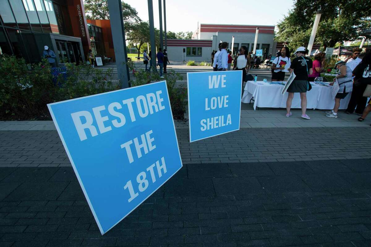 Signs supporting Rep. Sheila Jackson Lee during a rally against the redistricting efforts in Austin on Thursday, Oct. 7, 2021, at Emancipation Park in Houston, Texas.