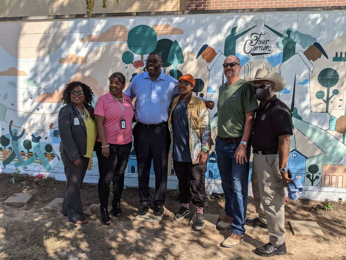A new mural by artist Nicole Ussery depicts the guardians of the garden. Pictured from left are Nicole Ledet, director of compliance and compensation at Fort Bend ISD; Carmen Turner, tax assessor-collector for Fort Bend County; Morris Gurnell, assistant minister at Fort Bend Church; Nicole Ussery, visual designer at Amazon; Fort Bend County Commissioner Ken DeMerchant; and Fort Bend County Sheriff Eric Fagan.