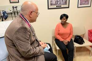 Dr. Richard Zelkowitz, breast oncologist and regional medical director of the breast program at St. Vincent's Medical Center and Hartford HealthCare, speaks with patient Carmen Brooks, 56, of Bridgeport. Brooks was diagnosed with breast cancer last year, but a gene expression test indicated that she did not need chemotherapy.