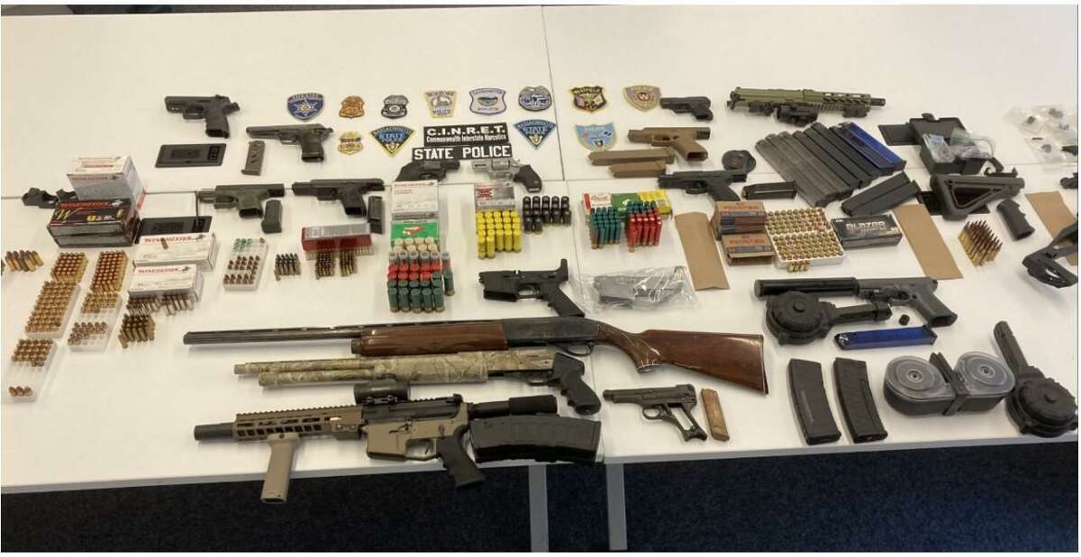 Weapons seized during a multi-state series of arrests by Connecticut State Police and authorities in Massachusetts