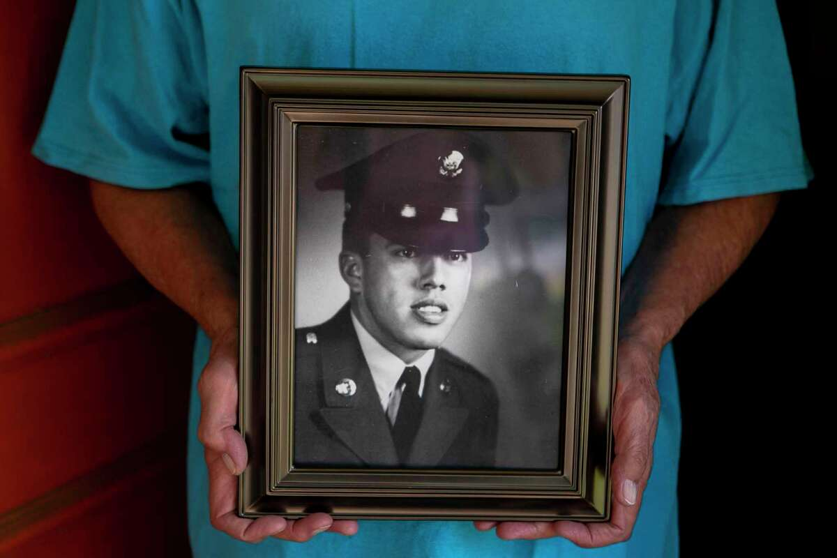 A reader pays tribute to Hispanic military members. Retired Army Sgt, Maj. Fred Navarro holds a portrait of himself when he was in the Army outside his home in San Antonio in 2019. Navarro became the 59th Air Force Medal of Honor recipient because of his bravery in 2000.