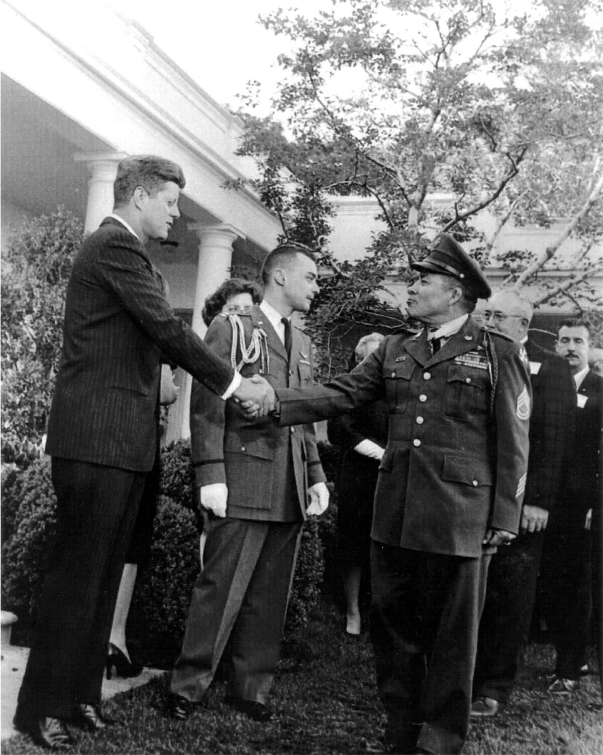 A reader pays tribute to Hispanic military members. Congressional Medal of Honor recipient Jose M. Lopez shakes hands with President John F. Kennedy in this undated photo.