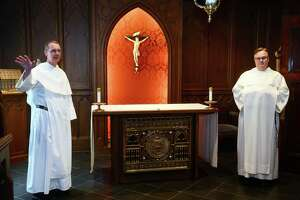 The Rev. John Paul Walker, left, and the Rev. Jordan Lenaghan in the chapel inside the priory at St. Mary Church in New Haven Oct. 7, 2021.