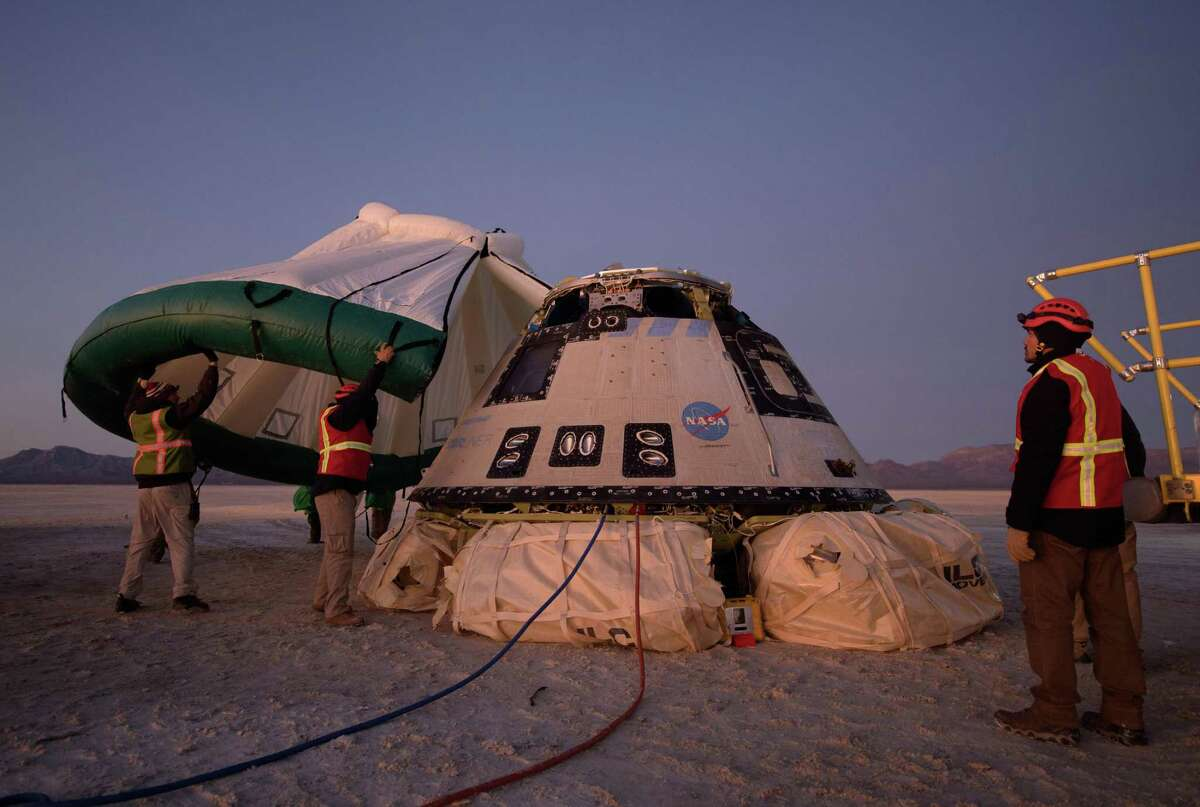 In an image provided by NASA, a protective tent is placed over Boeing's Starliner spacecraft in White Sands, N.M., Dec. 22, 2019. Officials say they are addressing technical issues in Boeing's newer spacecraft, the CST-100 Starliner.
