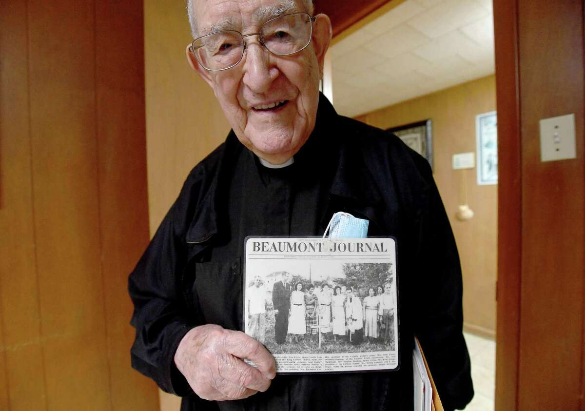 Fr. Luis Urriza holds a photo documenting the 1953 groundbreaking of Cristo Rey Catholic Church, which Fr. Luis started in 1951 after coming to America. Photo made Monday, October 4, 2021 Kim Brent/The Enterprise