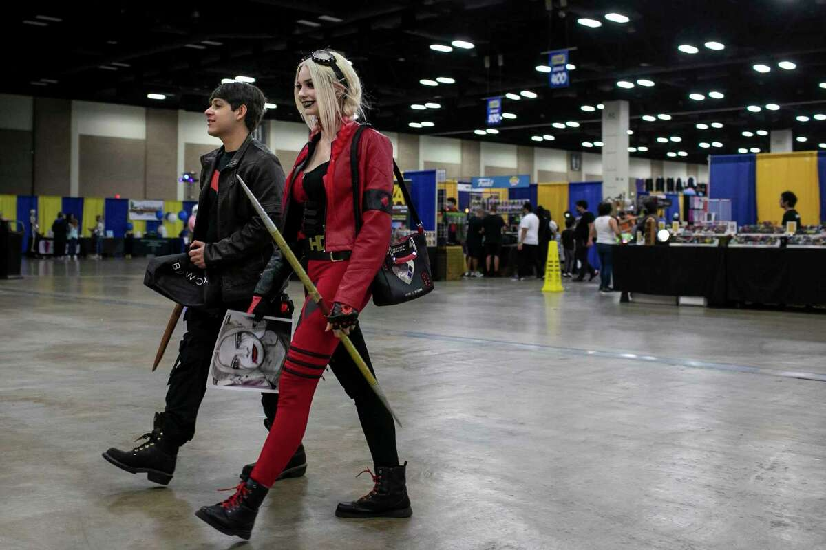 ABOVE: Thomas and April Markle of San Antonio walk through the exhibition hall during the Big Texas Comicon at the Henry B. Gonzalez Convention Center in San Antonio, Texas, on Oct. 8, 2021.