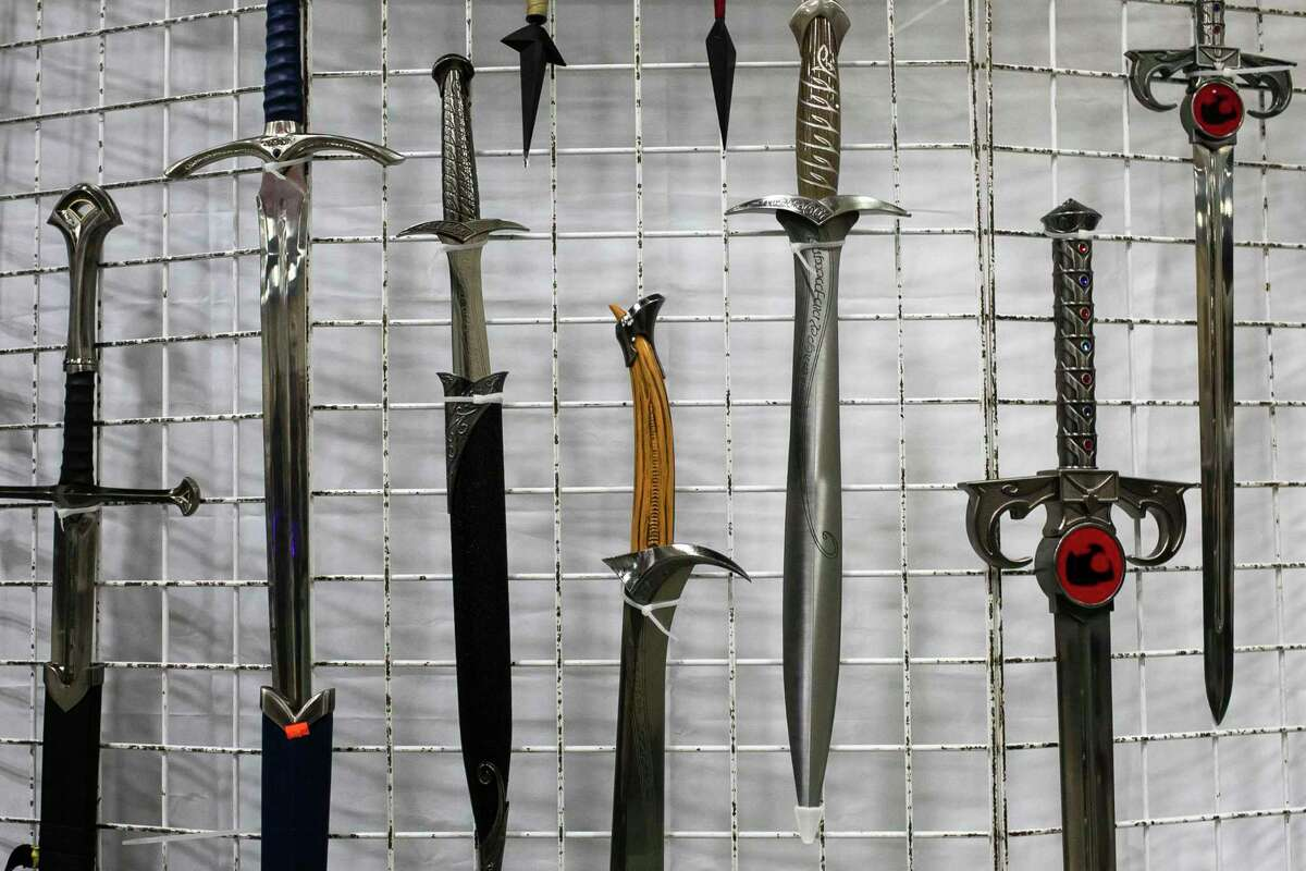 Swords and daggers hang on display during the Big Texas Comicon at the Henry B. Gonzalez Convention Center in San Antonio, Texas, on Oct. 8, 2021.