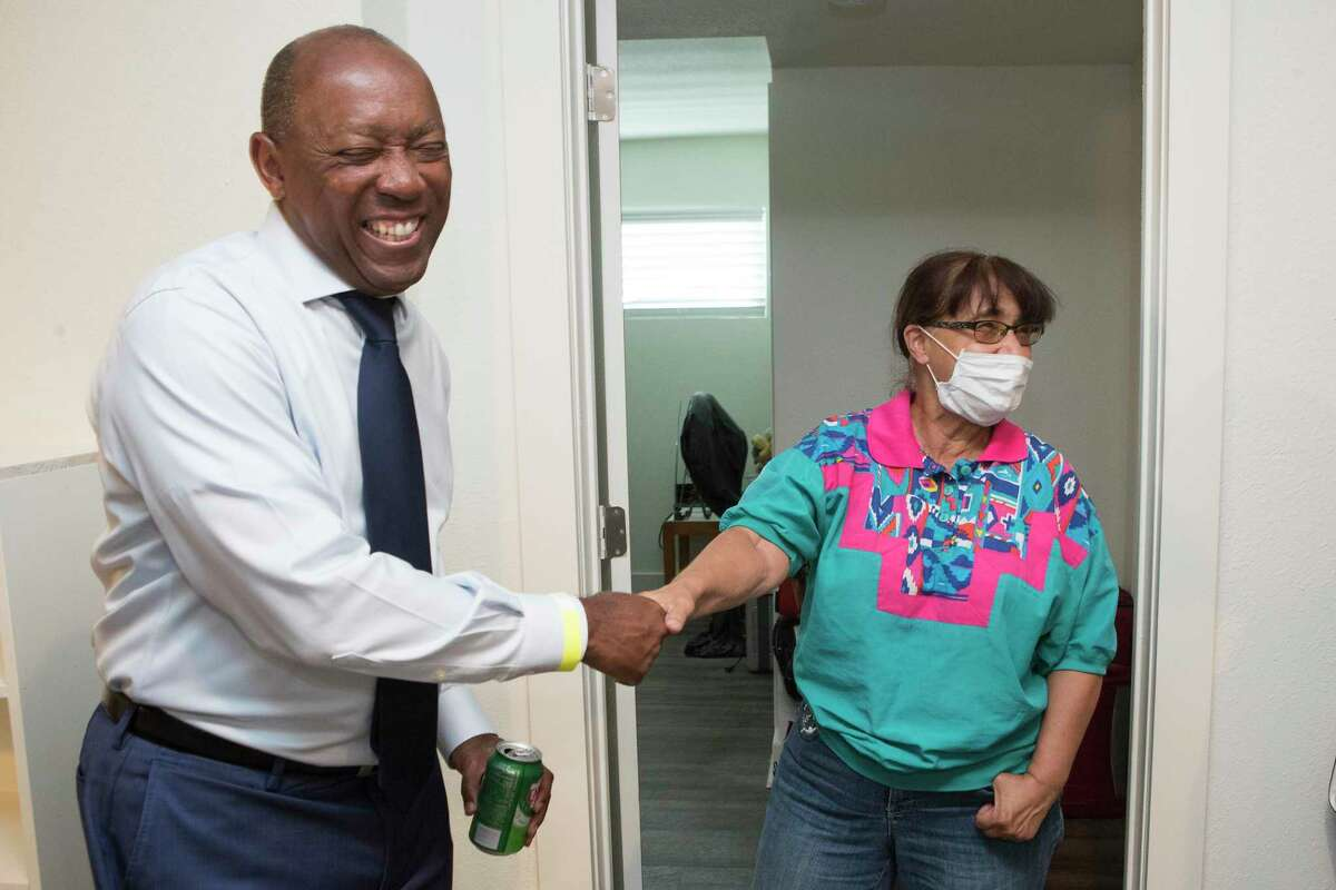 Mayor Sylvester Turner shook hands with Sally Manzano as he toured her renovated apartment during the grand reopening of Bellfort Park Apartments Wednesday, July 28, 2021 in Houston. Bellfort Park was the first development announced through the Harvey Multifamily Program to be approved by City Council and to reopen to residents.