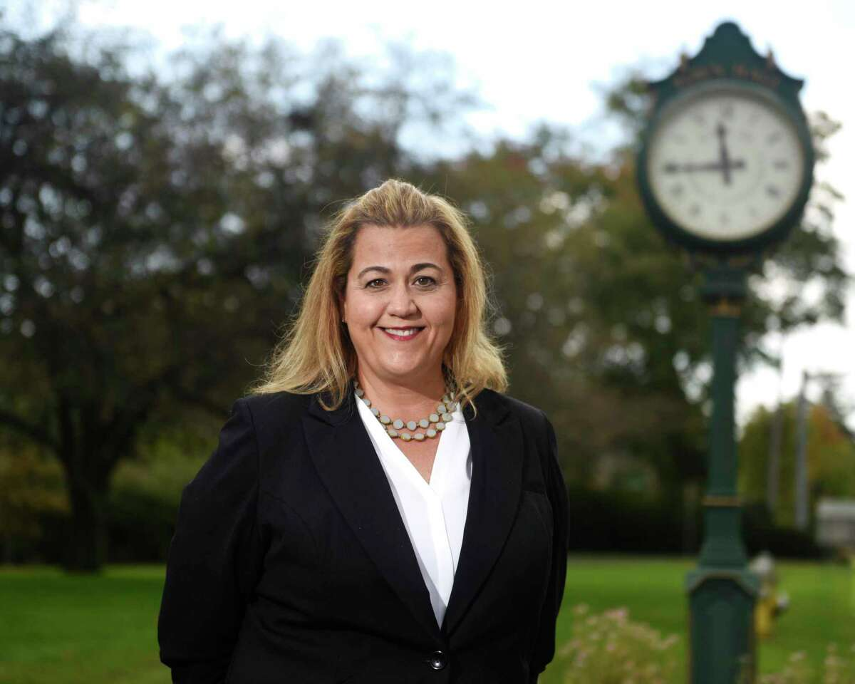 Republican candidate for Town Clerk Jackie Budkins poses outside Town Hall in Greenwich, Conn. Thursday, Oct. 7, 2021. Republican Jackie Budkins and Democrat Molly Saleeby are running against each other in the race for Town Clerk.