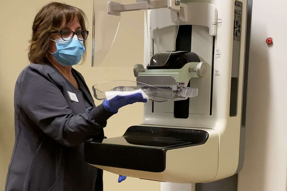 A mammography technologist cleans the SmartCurve system, which provides a curved compression surface giving women a much more comfortable experience without compromising image quality, according to Hologic's website. All Solis Mammography locations are equipped with the system.