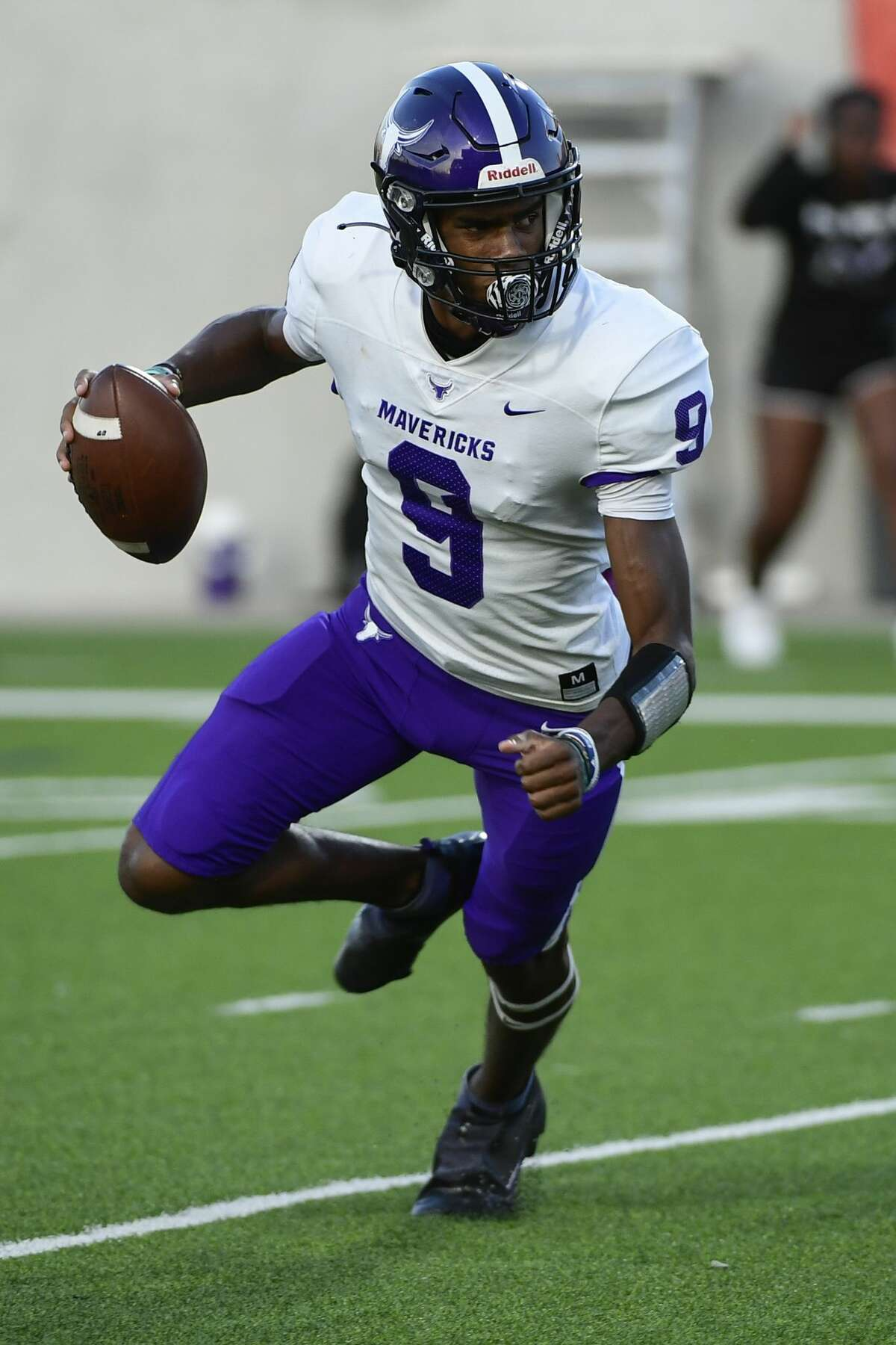 Morton Ranch's Josh Johnson (9) attempts to pass the ball during a District 19-6A high school football game at Legacy Stadium on Friday, Oct. 8, 2021, in Katy, Texas.