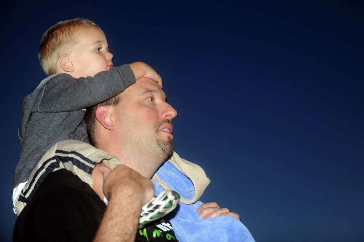 Two-year-old Grant Cyrulik sits on the shoulders of his father, Dan, as they wait for the beginning of the Riverlights Housatonic Boat Parade in Stratford on Saturday, September 18, 2010.