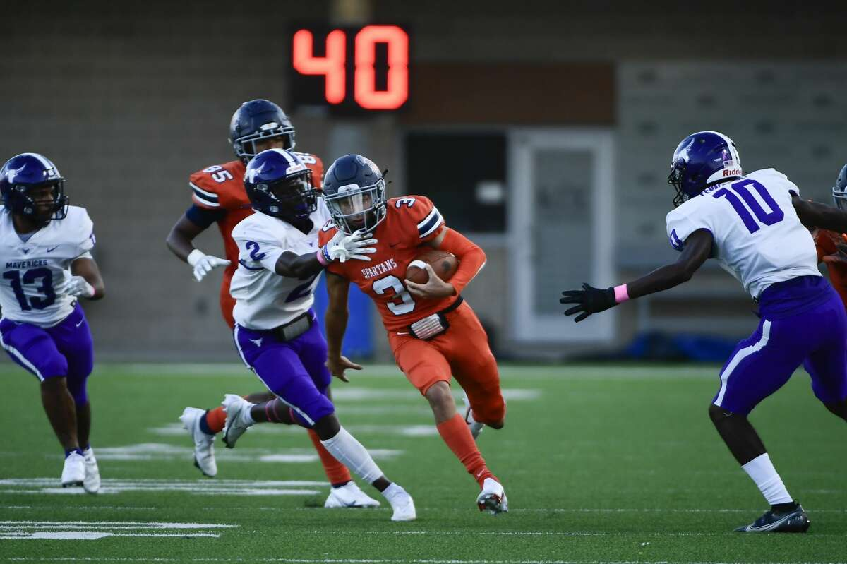 Seven Lakes' Grayson Medford (3) runs the ball against Morton Ranch during a District 19-6A high school football game at Legacy Stadium on Friday, Oct. 8, 2021, in Katy, Texas.