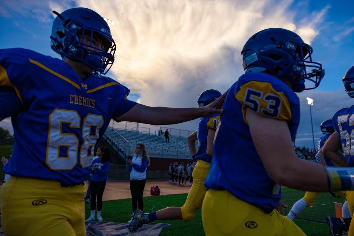 The Chemics take the field before their game against Davison Friday, Oct. 8, 2021 at Midland Community Stadium. (Drew Travis/for the Daily News)