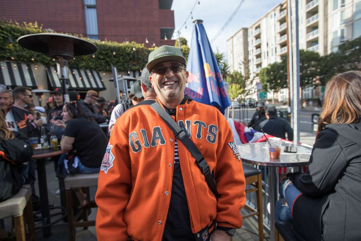 San Francisco Giants fan Rik Thomas has traveled from Idaho to watch Game 1 of the National League Division Series.  He had a drink on MoMo's crowded outdoor terrace on October 8, 2021.