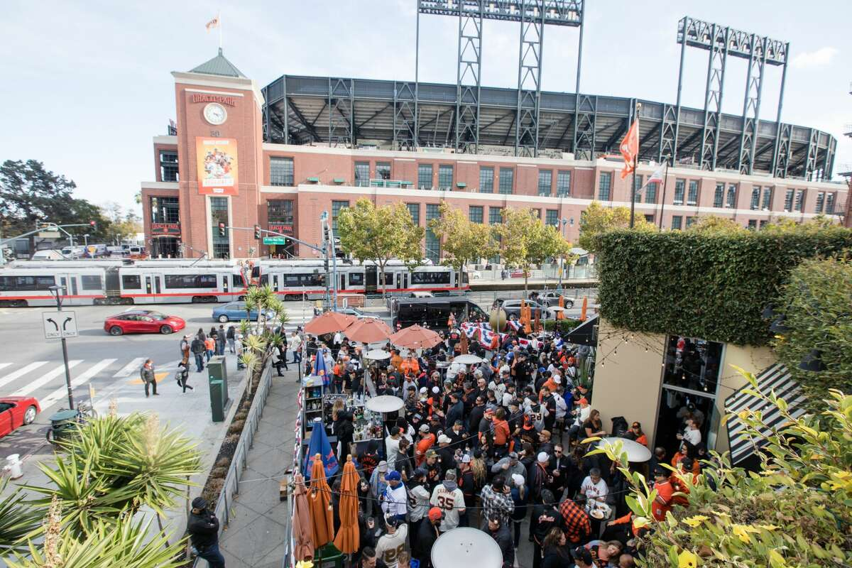 San Francisco Giants fans packed outdoors patio at MoMo's, a sports bar and restaurant which sits across the street from Oracle Park in San Francisco, California, on Oct. 8, 2021 before game one of the National League Division Series.