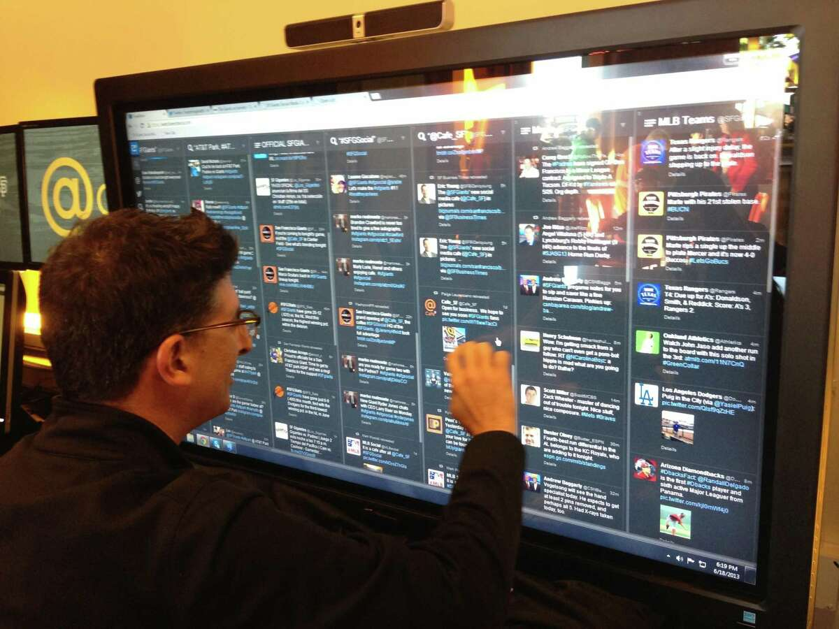 Bryan Srabian, the Giants' social media director, surfs the large touch-screen Tweetdeck his team uses to track and feature Giants fans' tweets.