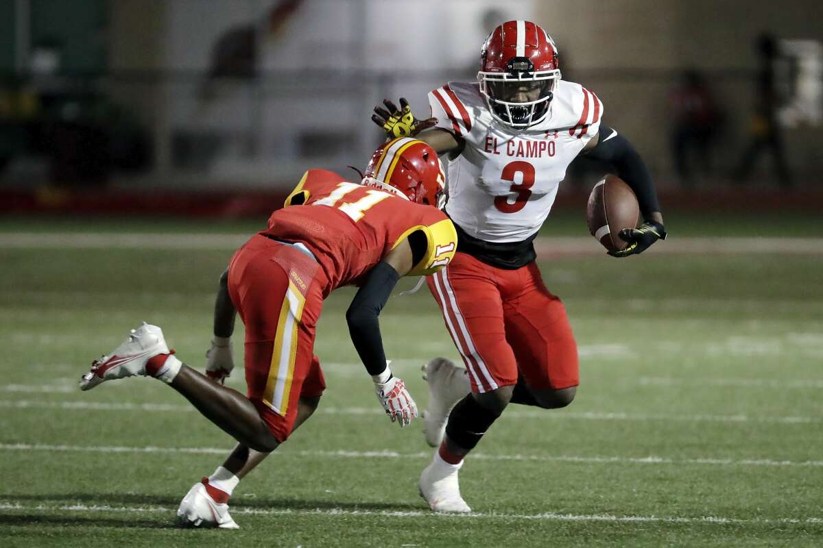 El Campo running back Jontre Davis (3) pushes off the tackle attempt by Stafford defender Javon Rhodes (11) during the first half of a high school football game Friday, Oct. 8, 2021 in Houston, TX.