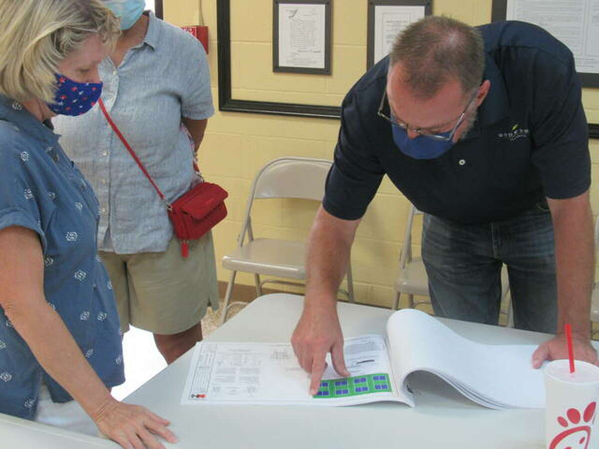 Godfrey Village Engineer Rich Beran speaks with village residents Thursday night about pickleball courts. Godfrey trustees recently voted to double the number of courts, from four to eight.
