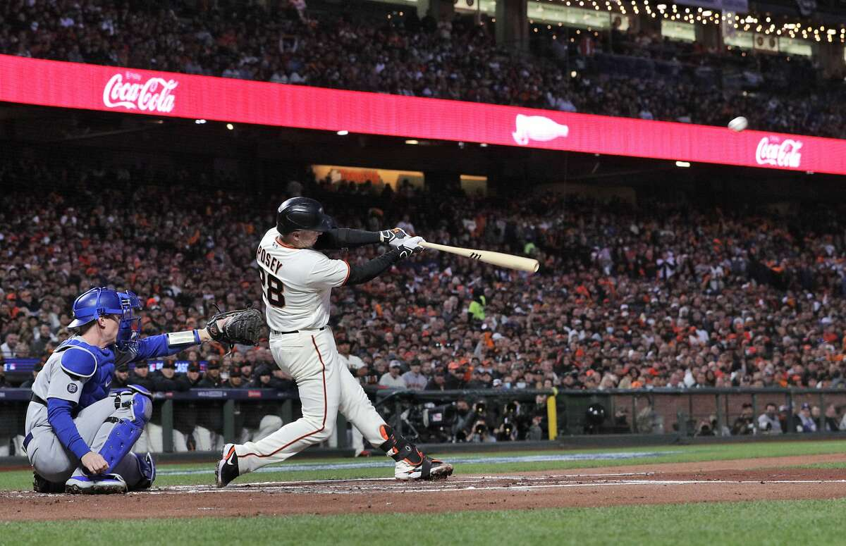 Buster Posey (28) hits his first inning two run homerun as the San Francisco Giants played the Los Angeles Dodgers in Game 1 of the National League Division Series at Oracle Park in San Francisco, Calif., on Friday, October 8, 2021.