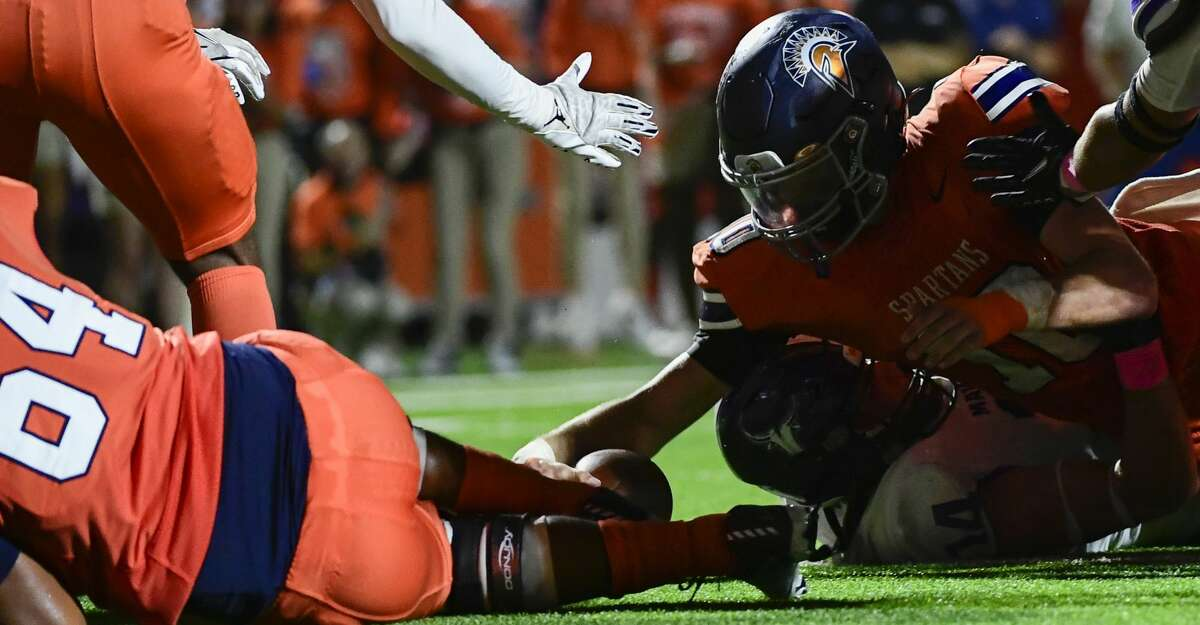 Seven Lakes' Scott Stanford (10) scores the game winning touchdown against Morton Ranch during a District 19-6A high school football game at Legacy Stadium on Friday, Oct. 8, 2021, in Katy, Texas.