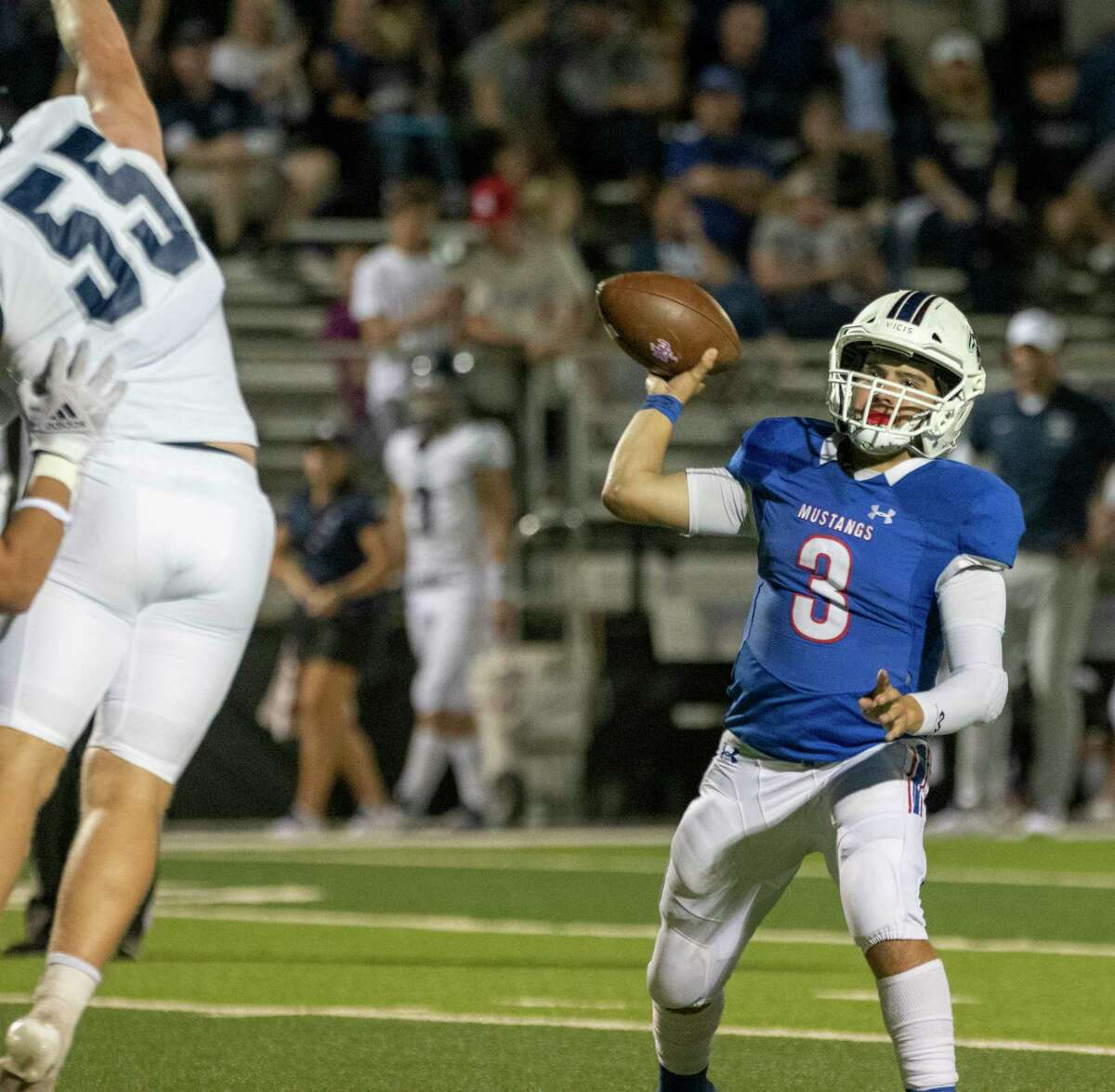 Midland Christian's Ryver Rodriguez looks to pass as Libert Christian's David O'Neal tries to knock it down 10/08/2021 at Gorgon Awtry Field. Tim Fischer/Reporter-Telegram