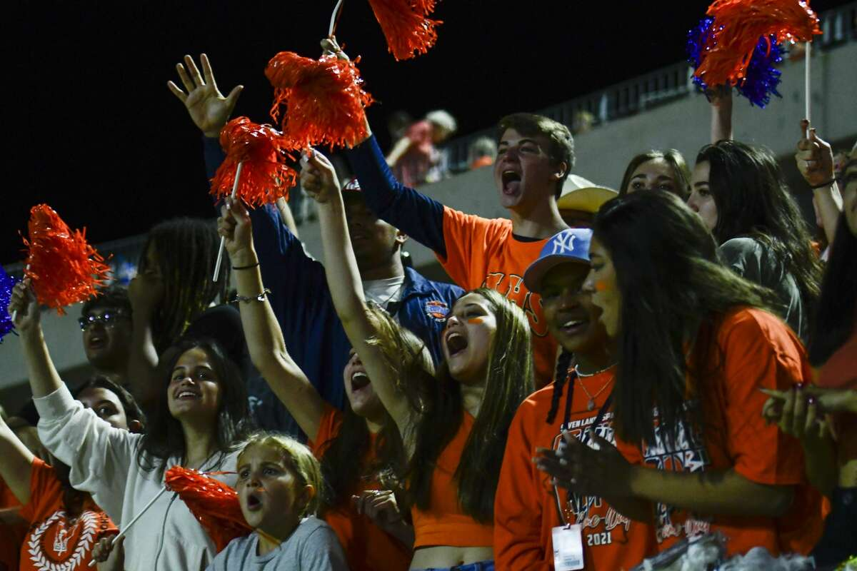 Seven Lakes fans and students react to winning against Morton Ranch after a District 19-6A high school football game at Legacy Stadium on Friday, Oct. 8, 2021, in Katy, Texas.