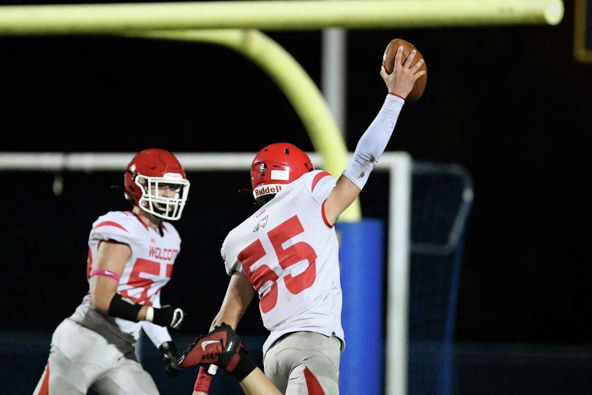 Wolcott's Quinn Pawlak returns an interception for a first half touchdown against Seymour High Friday night.