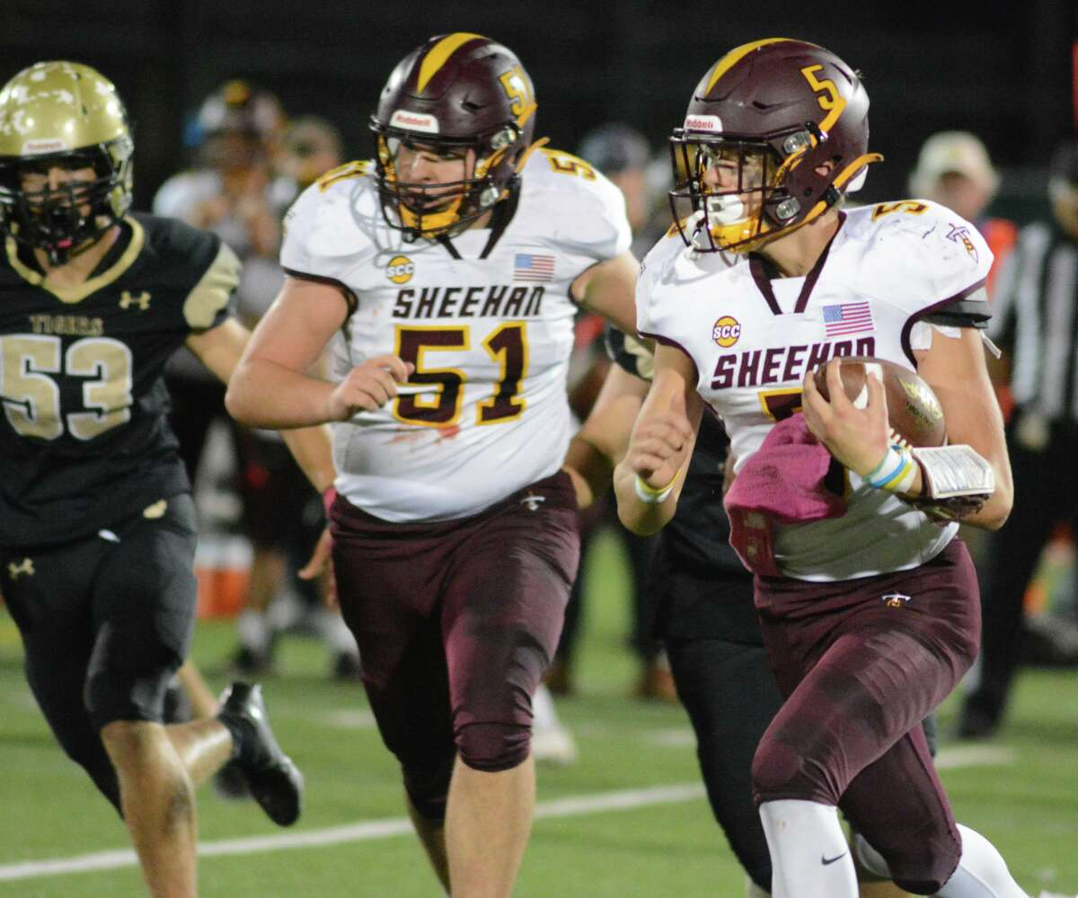 Jacob Shook (5) of Sheehan carries the ball Friday night.