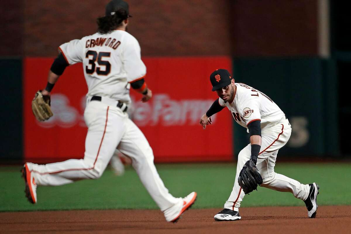 Tommy LaStella fields a grounder before his flip to Brandon Crawford (35) started a memorable double play Friday.