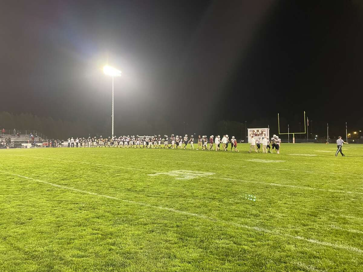 Cass City and USA shake hands after the homecoming game.