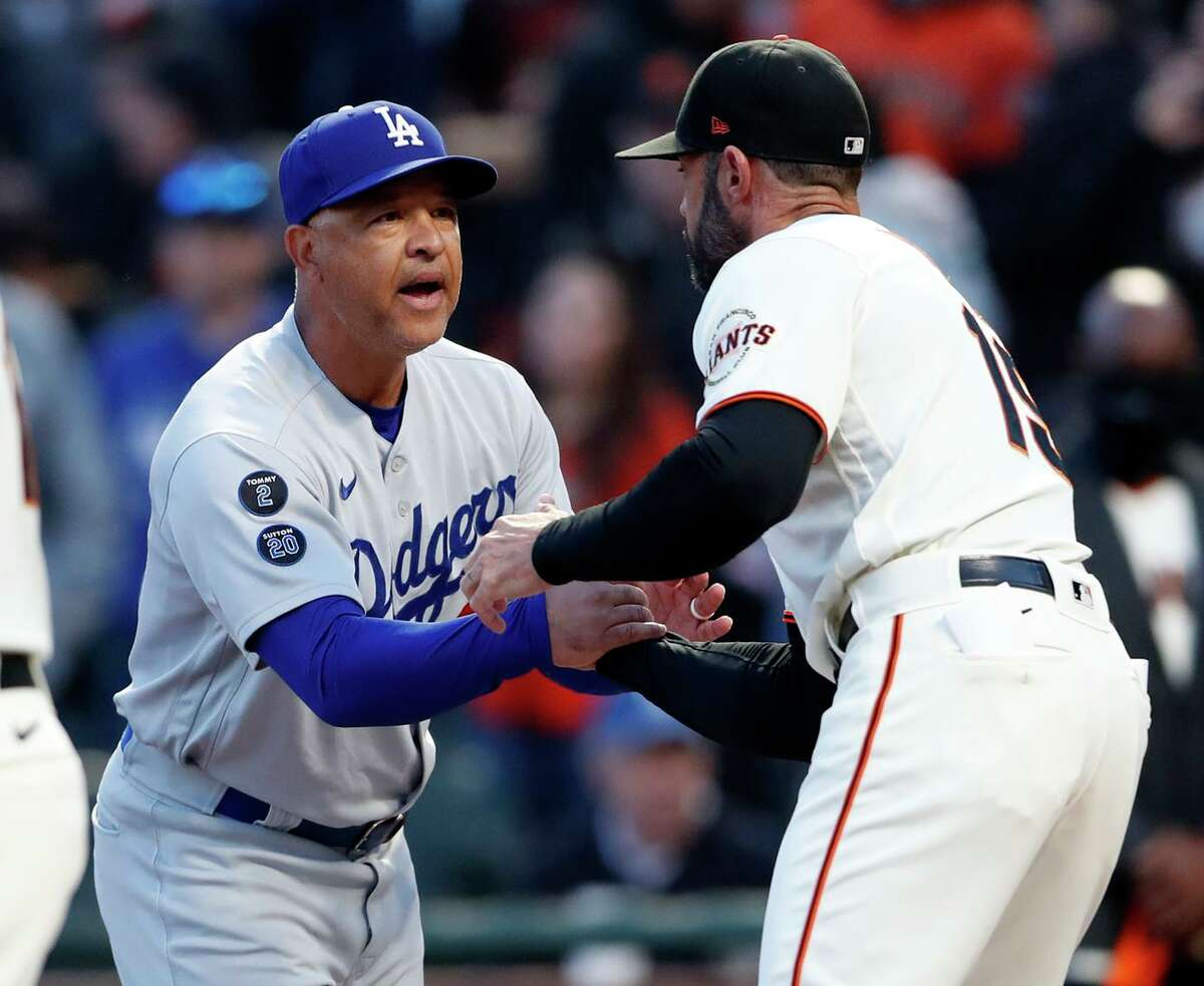 Dodgers manager and former Giants player Dave Roberts greets Giants manager Gabe Kapler before Friday night's Game 1 of the National League Division Series at Oracle Park.