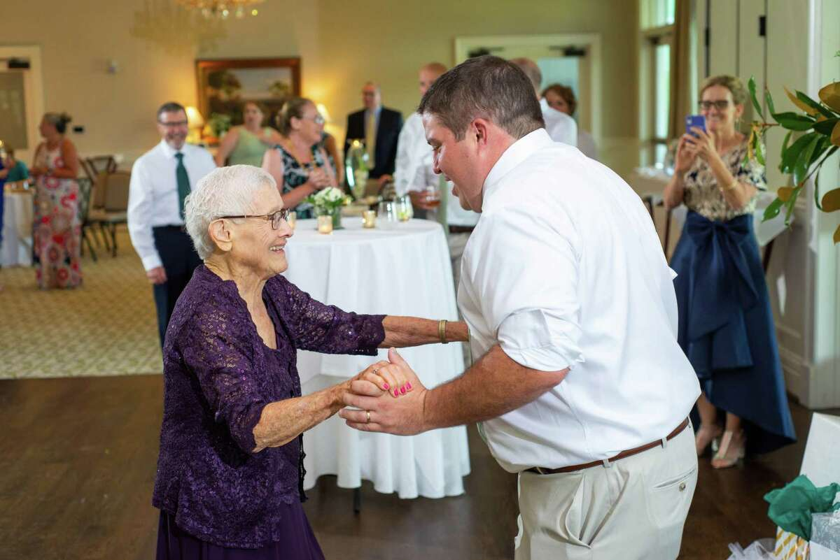 When 96-year-old Tennie Ivy was first diagnosed with triple-negative breast cancer last November, her initial inclination was to allow the disease to take its course. But she had one final item on her bucket list--attend her youngest grandson's wedding. She got her dance with Andrew Haag at the reception at the Greenville Country Club, Greenville, SC.courtesy of: Complete weddings + events, Greenville, SC