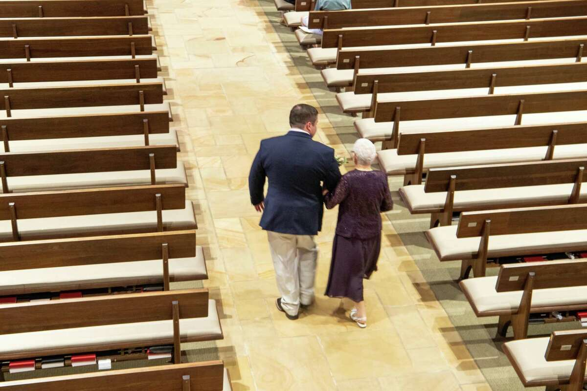 Andrew walking Tennie down the aisle of Westminster Presbyterian Church in Greenville, South Carolina to her seat before the wedding started. It was her last grandson to get married. Both photos courtesy of: Complete weddings + events, Greenville, SC