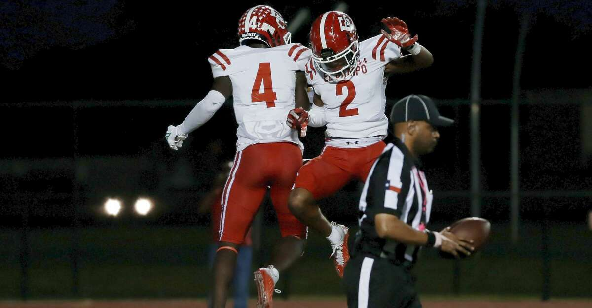 El Campo's Rueben Owens (4) and DeKoreyus Ward (2) celebrate the touchdown by Owens against Stafford during the first half of a high school football game Friday, Oct. 8, 2021 in Stafford, TX.