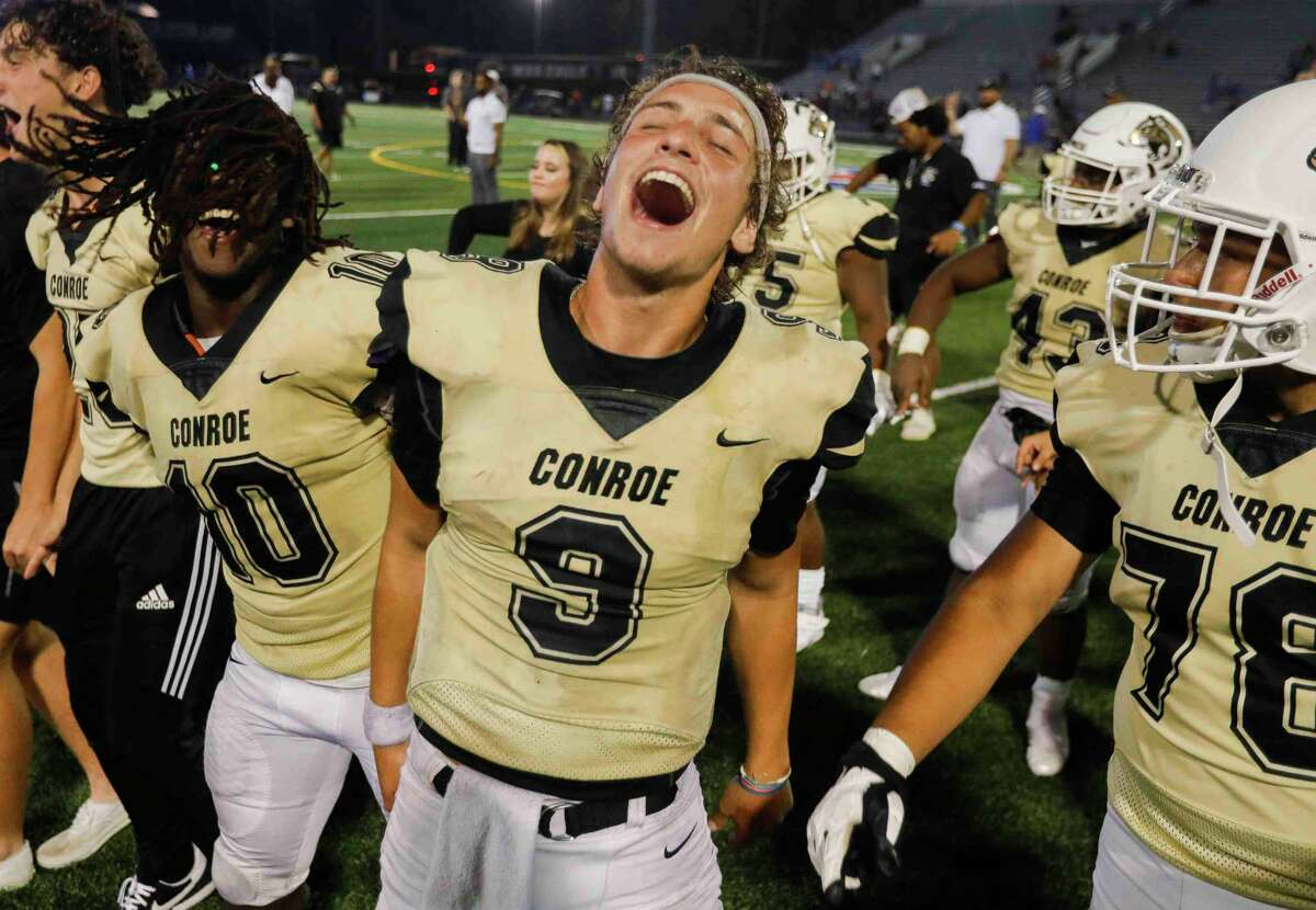 Conroe starting quarterback Clayton Garlock (9) reacts after defeating Oak Ridge 44-41 on homecoming during a District 13-6A high school football game at Buddy Moorhead Stadium, Friday, Oct. 8, 2021, in Conroe.