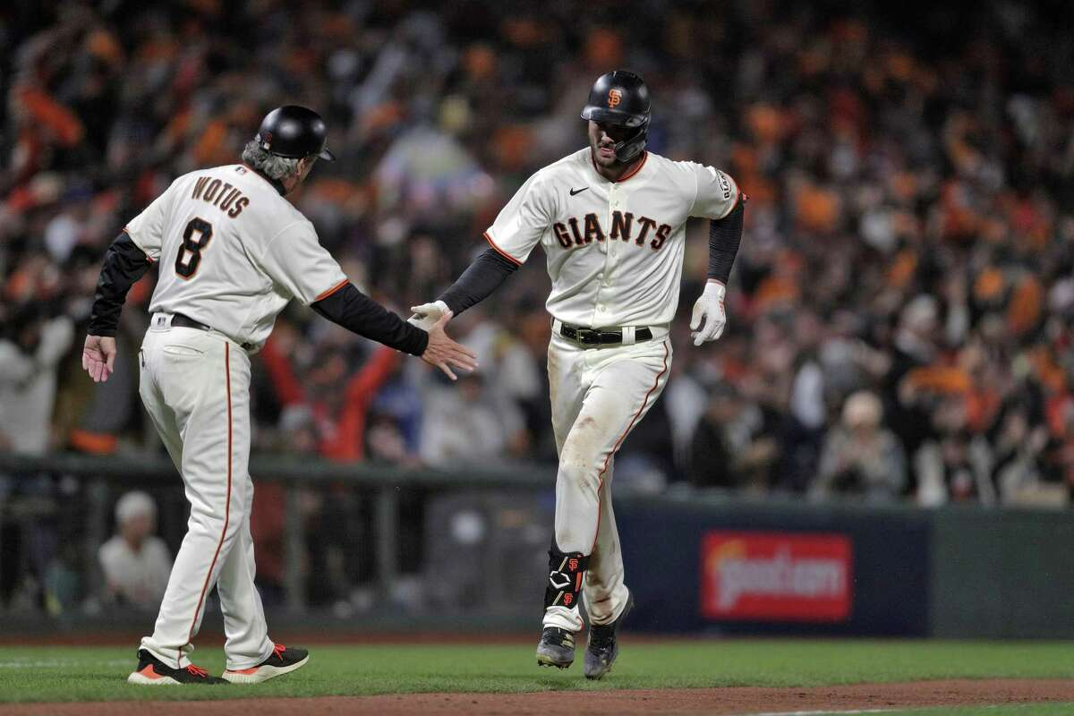 Kris Bryant (23) rounds the bases after hitting a solo homerun in the seventh inning as the San Francisco Giants played the Los Angeles Dodgers in Game 1 of the National League Division Series at Oracle Park in San Francisco, Calif., on Friday, October 8, 2021.