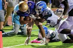 CBA running back Donald Jones scores a touchdown before being dragged down by Shaker defender Malachi Moore during a Class AA matchup of unbeaten teams at CBA High School in Colonie on Friday, Oct. 8, 2021 (Jim Franco/Special to the Times Union)
