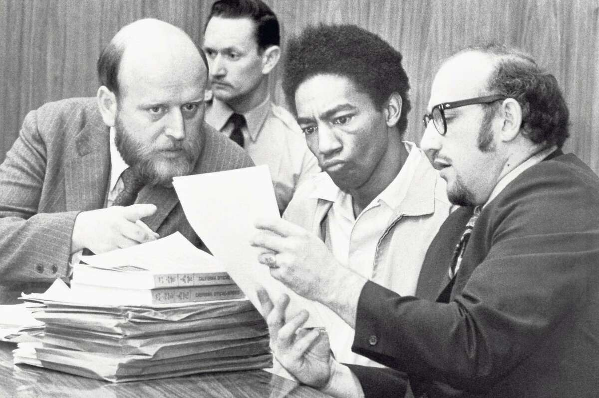 Ruchell Magee (second from right) has been in prison for 50 years, while the shooter of President Ronald Reagan is free.