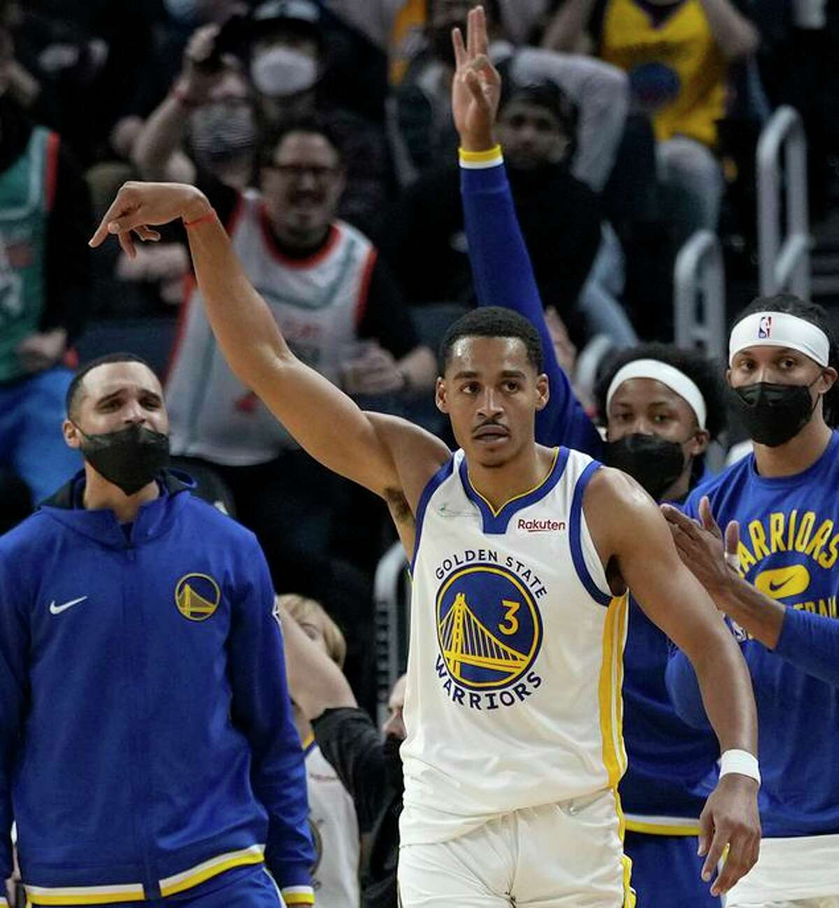 Jordan Poole of the Warriors reacts after hitting a 3-pointer against the Lakers.