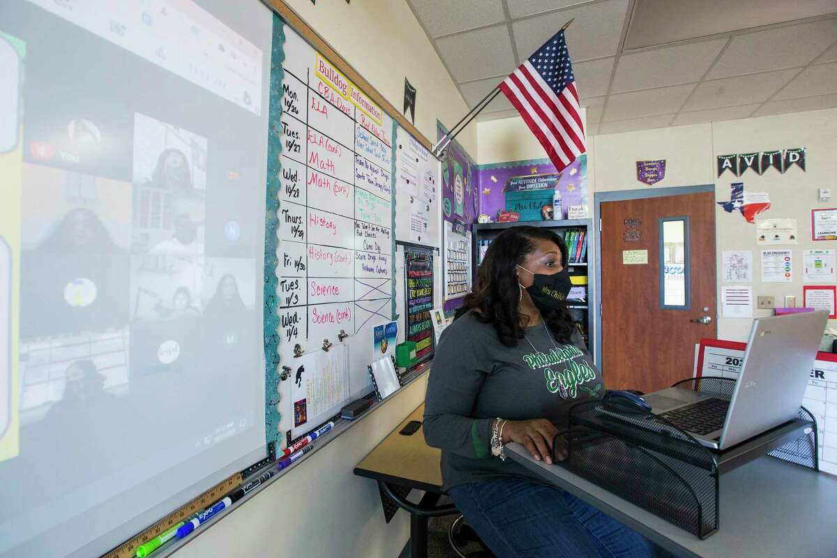 Cheryl Childs, A.V.I.D teacher, teaches her students, both virtual and in-person students in her classroom at Aguirre Junior High in Channelview ISD Tuesday, Oct. 27, 2020 in Channelview. With the Texas Legislature having approved funding for virtual learning for the 2021-2022 school year, Spring Branch ISD plans to offer a virtual learning option for children under 12 years old, for whom a COVID-19 vaccine has not yet been approved.