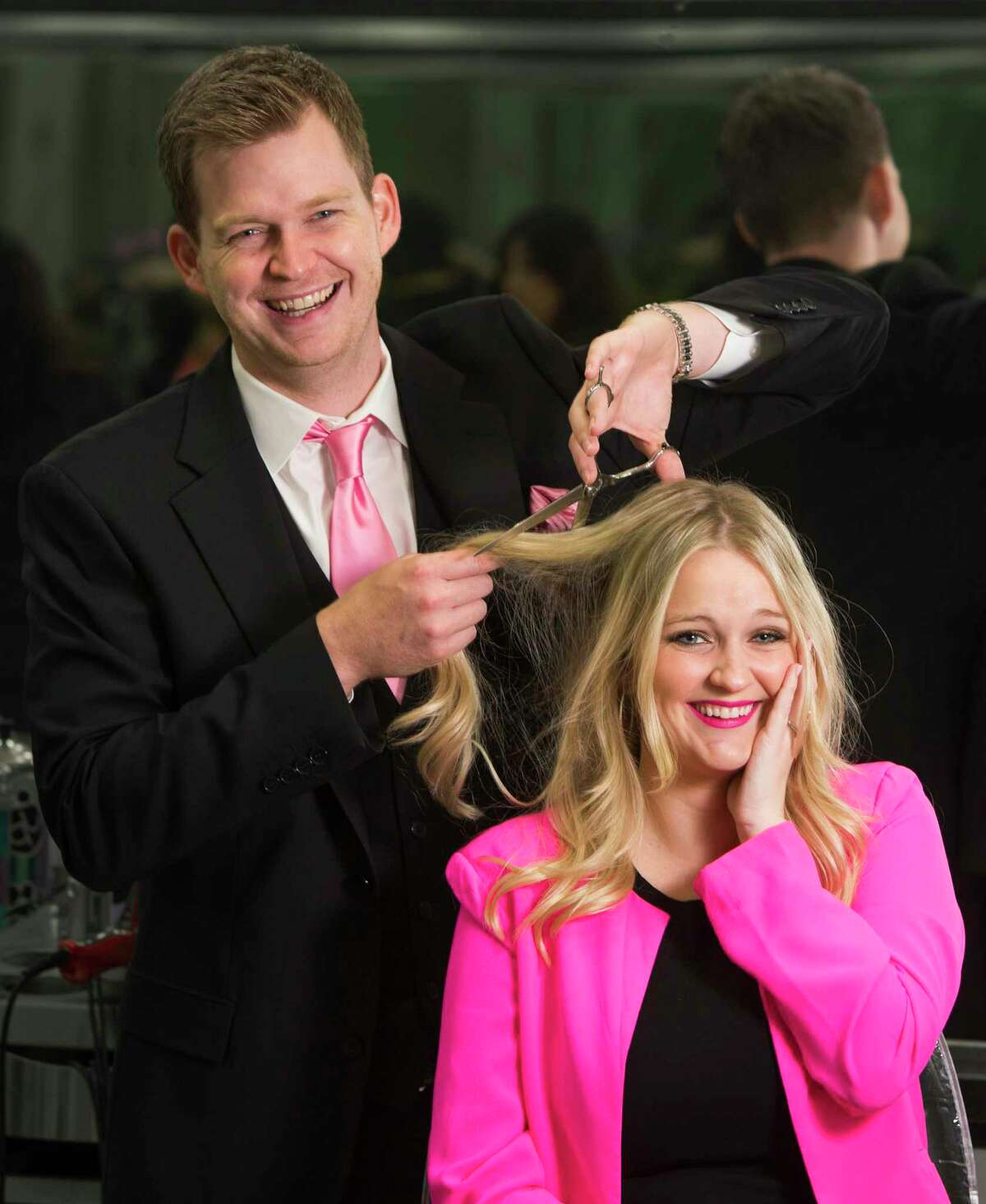 Visible Changes president Johnny McCormack, left, and his sister Meagan McCormack pose for a portrait at the salon in the Galleria on Wednesday, Oct. 8, 2014, in Houston. Maryanne McCormack began with one salon in 1977 at the Greenspoint Mall in Houston. The company has grown to include 17 salons across the state of Texas. ( Brett Coomer / Houston Chronicle )