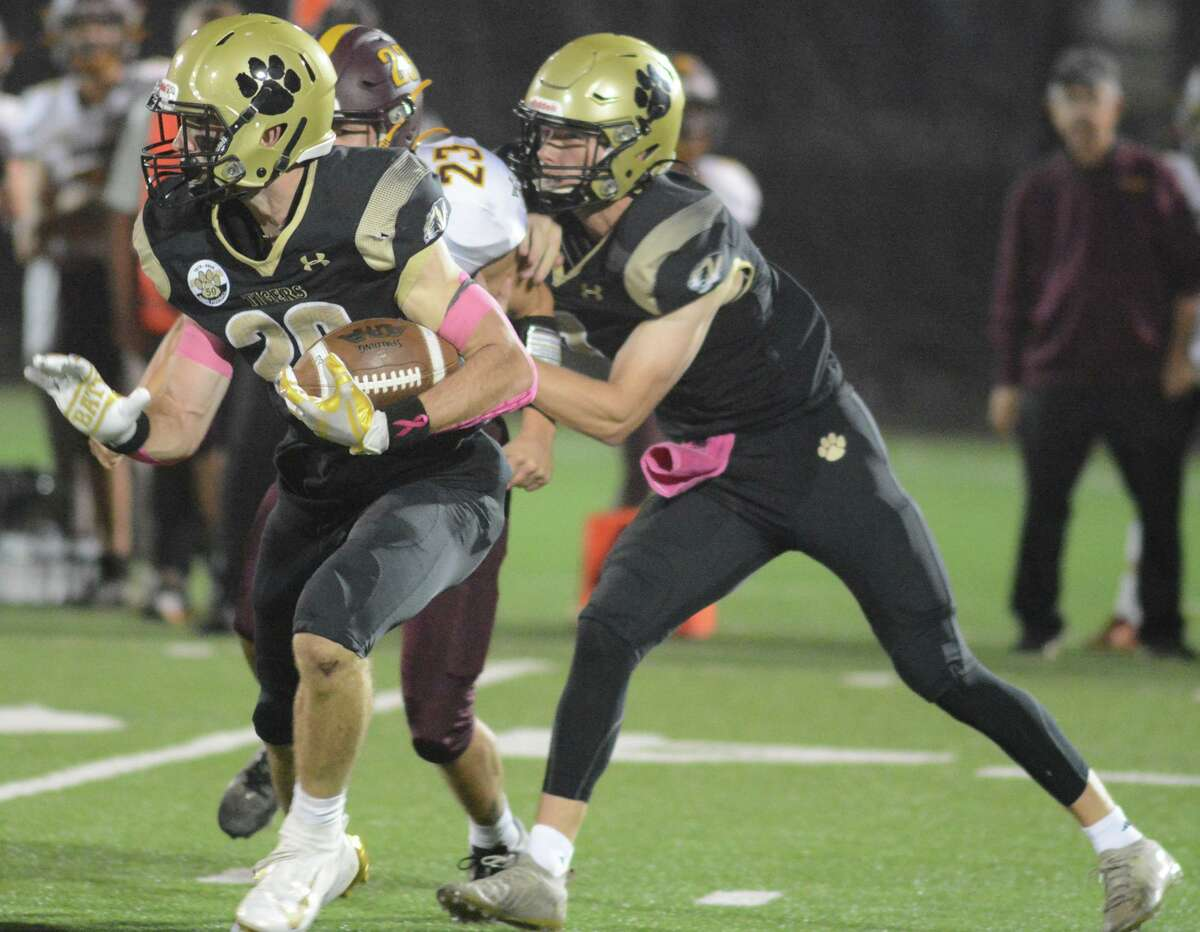 Ethan O'Brien (20) of Hand carries the ball against Sheehan on Friday night.