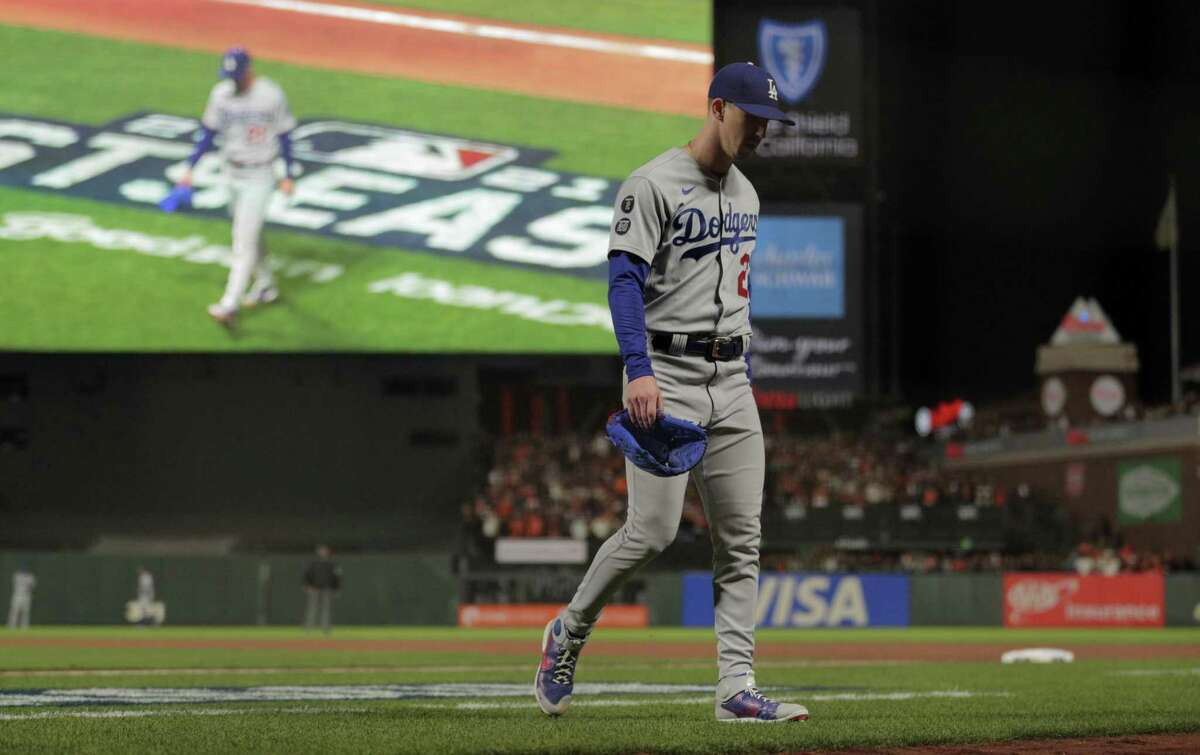 Dodgers starter Walker Buehler (21) departs the game in the seventh inning after being relieved as the San Francisco Giants played the Los Angeles Dodgers in Game 1 of the National League Division Series at Oracle Park in San Francisco, Calif., on Friday, October 8, 2021.