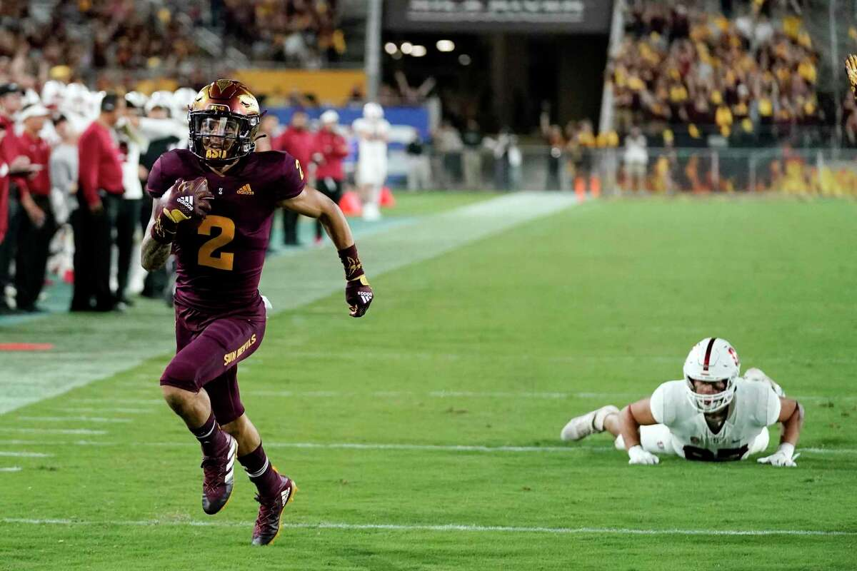 Arizona State defensive back DeAndre Pierce returns a lateral after an interception for a touchdown Friday night against Stanford.